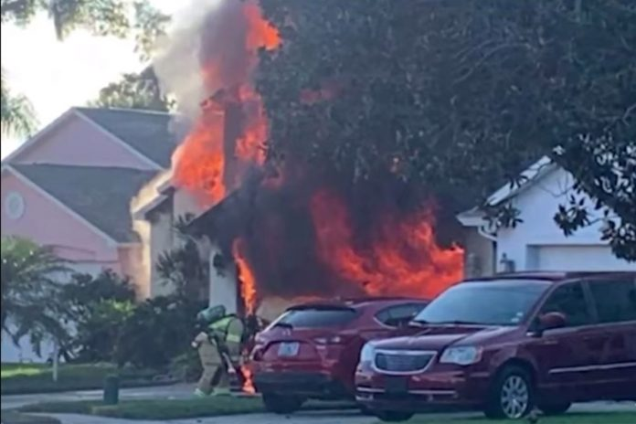 Amazon delivery driver saves elderly man from burning house