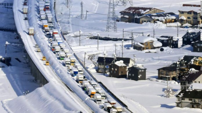 Over 1000 people were stuck overnight in a 9 miles long traffic jam in Japan