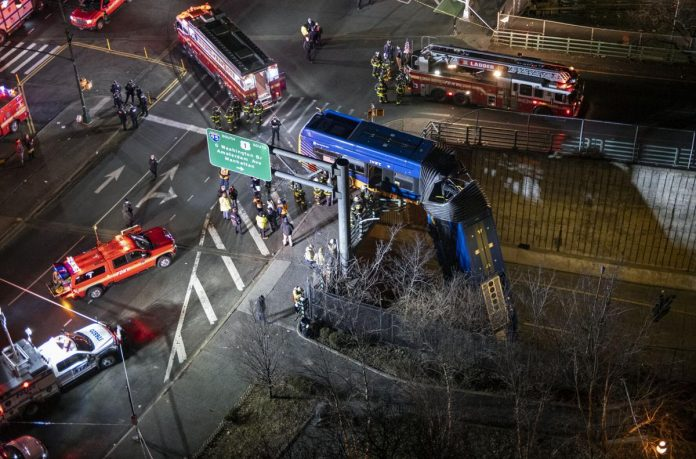 New York City bus left dangling from overpass after accident, injuring 8